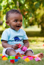 Little Baby Boy Playing In The Grass Stock Photo - 25125950