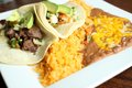 Steak Tacos With Beans And Rice Royalty Free Stock Images - 25128319