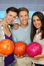 Two Men And Girl Hold Balls In Bowling Club Stock Photos - 25150523