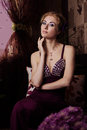 Retro-styled Woman In Violet Dress Royalty Free Stock Image - 25160926