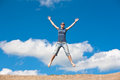 Jumping Girl With Hands Up Against Stock Photos - 25174803