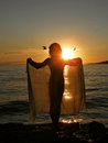 Girl In Sunset With Scarf And Birds Stock Photo - 25196130
