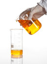 Hand Holds Flask To Make A Chemical Reaction Royalty Free Stock Images - 25204009