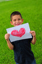 Young Boy Holding Heart Drawing Royalty Free Stock Photo - 25212345