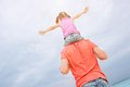 Father Carrying His Daughter On Shoulders Royalty Free Stock Image - 25219846