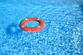 Life Belt Floating On Water Royalty Free Stock Photo - 25225355