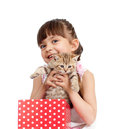 Happy Child Girl Takes Cat Out Gift Box Royalty Free Stock Photography - 25237637
