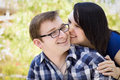 Young Couple Snuggling In The Park Stock Image - 25264851