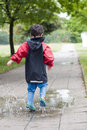 Child In Puddle Royalty Free Stock Photography - 25284287