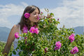 Smelling A Rose Royalty Free Stock Image - 25288336