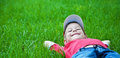 Boy Laying On Grass. Family Picnic In Spring Park Royalty Free Stock Photos - 25290068