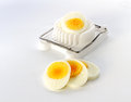 An Egg Slicer And Sliced ​​egg Royalty Free Stock Image - 25307086