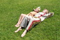 Little Girl And Boy Sleaping On Grass Stock Photo - 25320210