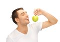 Man In White Shirt With Green Apple Stock Images - 25325724