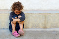 Poor, Sad Little Child Against The Concrete Wall Stock Images - 25332574