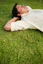 Man Lying In Grass With His Eyes Closed Royalty Free Stock Images - 25332979