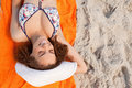 Overhead View Of A Smiling Young Woman Lying On Her Beach Towel Stock Photo - 25333390
