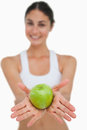 Close-up A Green Apple Holding By A Brunette Stock Image - 25335601