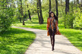 Young Woman Walking In A Park Royalty Free Stock Images - 25338319