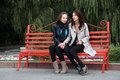 Two Girls In Park. Royalty Free Stock Photography - 25341177