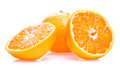 One Ripe Juicy Tangerine And Two Half  Royalty Free Stock Image - 25344416