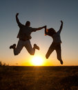 Young Happy Couple Jumping High In The Air Stock Images - 25376384