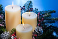 Three Candles In An Advent Flower Arrangement Stock Image - 25390071