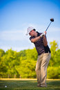 Young Golfer Swing Club Stock Photo - 25398080