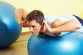 Man Exercising On Gym Ball Royalty Free Stock Photography - 25399747