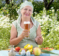The Adult Woman Drinks The Fresh Cooled Dark Barle Royalty Free Stock Image - 25418066