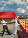 Married Couple With White Umbrella On The Roof Royalty Free Stock Image - 25430156
