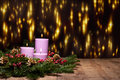 Three Candles In An Advent Flower Arrangement Royalty Free Stock Images - 25431719