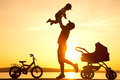 Happy Father With Child  On Sunset Royalty Free Stock Images - 25460649