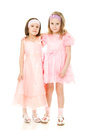Two Girlfriends Hugging Dresses In Pink Stock Images - 25465854