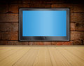 Lcd TV Screen On Brick Wall And Wood Floor Stock Photos - 25467363