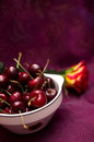 Cherries On Red Royalty Free Stock Photo - 25486685