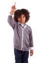 Little African American Boy With Finger Up Royalty Free Stock Photo - 25499315