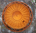 Rusty Red Sewer Hatch Royalty Free Stock Photos - 2553848