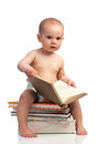 Little Boy Sitting On A Stack Of Books Royalty Free Stock Image - 25510116