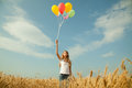 Teen Girl At A Wheat Field With Balloons Royalty Free Stock Images - 25521749