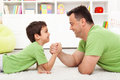 Father And Son Arm Wrestling Royalty Free Stock Image - 25543476