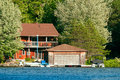Cottage With A Boathouse Royalty Free Stock Photos - 25551538