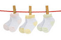 Three Pairs Baby Socks Hanging Royalty Free Stock Photos - 25556448