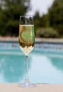 Flute Of Cold Champagne By Side Of Pool Royalty Free Stock Photos - 25563118