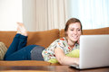 Woman Relaxed With Her Laptop. Royalty Free Stock Images - 25565359