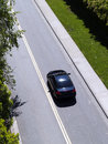Car Driving Down Road From Above Green Grass Royalty Free Stock Images - 25576329