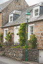Scottish Terraced Cottage With Roses Royalty Free Stock Photos - 25576838