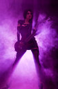 Sexy Woman Playing Guitar Royalty Free Stock Image - 25577676