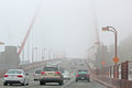 Traffic On The Foggy Golden Gate Bridge Royalty Free Stock Photos - 25605378
