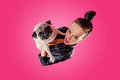 Overhead View Of Woman With Pug Stock Photo - 25606430